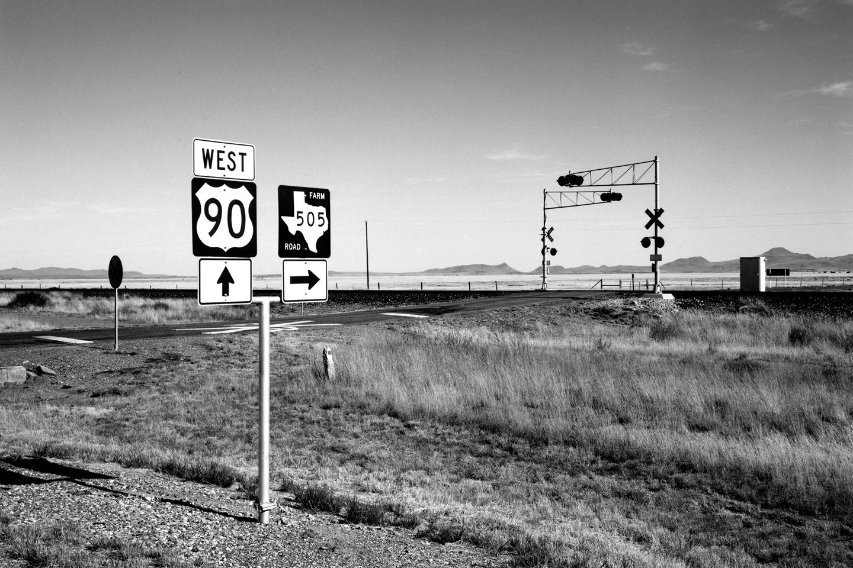 Lothar Baumgarten, Lothar Baumgarten, Southern Pacific Transportation Co. and Amtrak's Sunset Limited, Railroad crossing Jefferson Davis County, Texas, 1989. From Carbon, 1989. © Lothar Baumgarten. Courtesy: Marian Goodman Gallery, New York