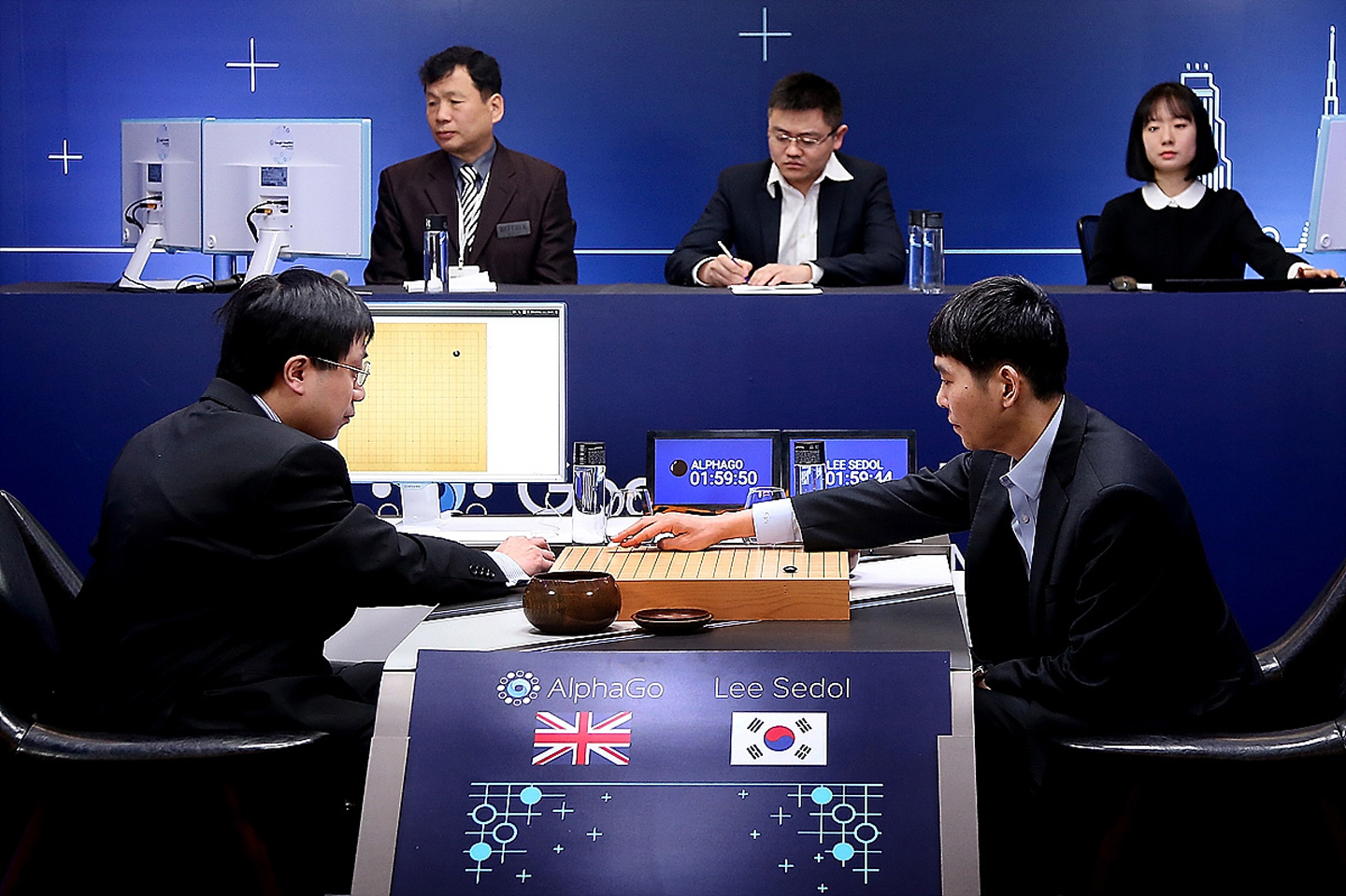 The world's top Go player Lee Sedol (on the right) playing against Google's artificial intelligence program AlphaGo during the Google DeepMind Challenge Match in Seoul, South Korea, 10 March 2016. Photo: © Handout / Getty Images