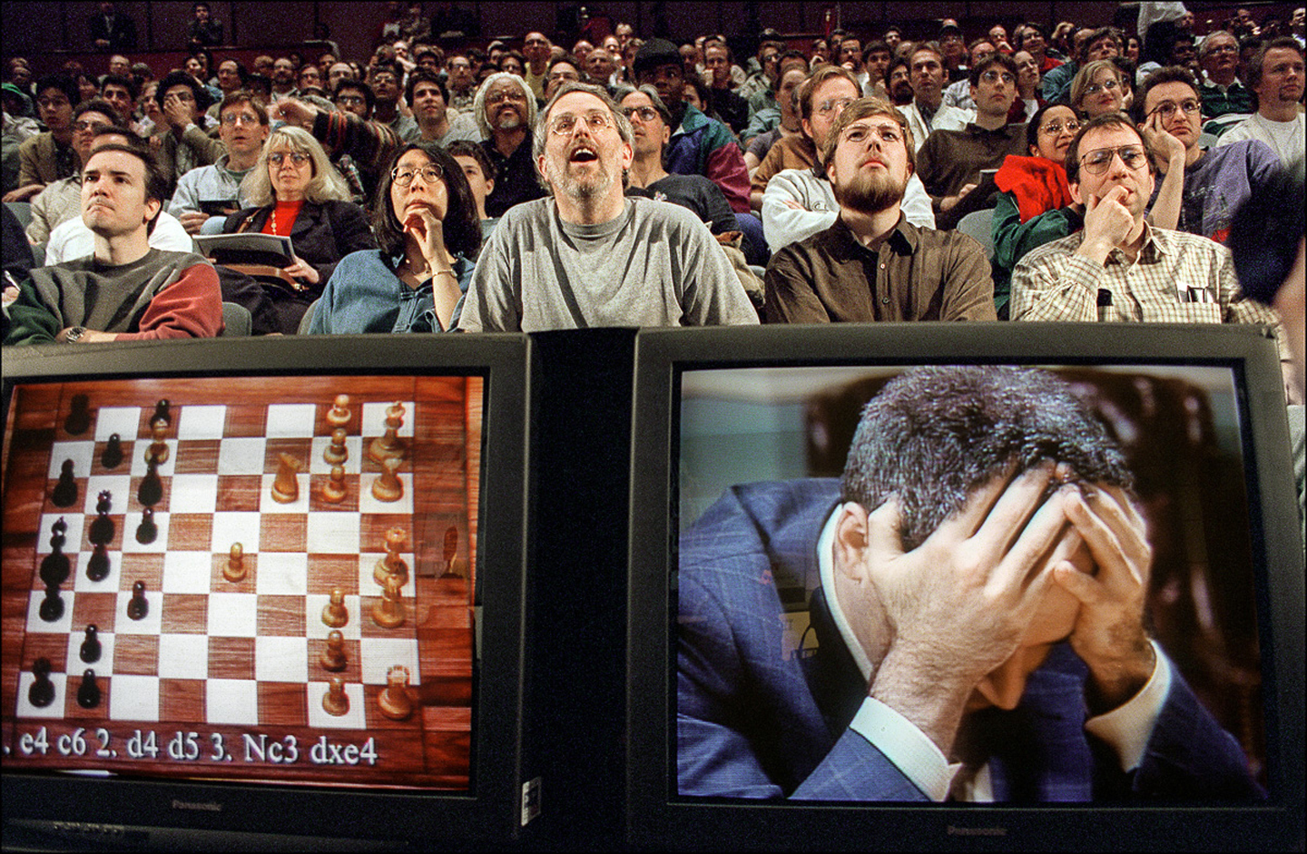 Garry Kasparov holding his head at the start of the sixth and final match against IBM's Deep Blue computer, New York, 1997. Photo: © Stan Honda / AFP / Getty Images