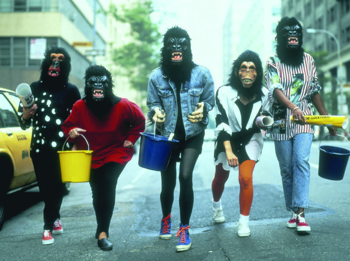 Guerrilla Girls running with brushes and glue, late 1980s. Courtesy: the artists